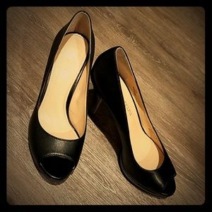 Black Leather Peep Toe heels by Enzo Angiolini